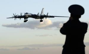 453565-a-russian-officer-takes-a-picture-of-a-tu-95-bomber-or-bear-at-a-milit